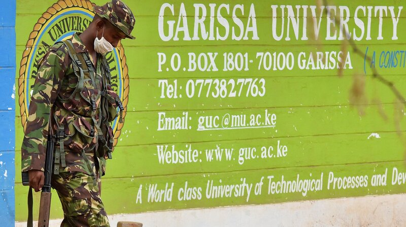 A Kenya soldier walks past the front entrance of Garissa University Friday. Kenya's interior minister vowed that the country would not bow to terrorist threats, a day after the massacre of 147 students.