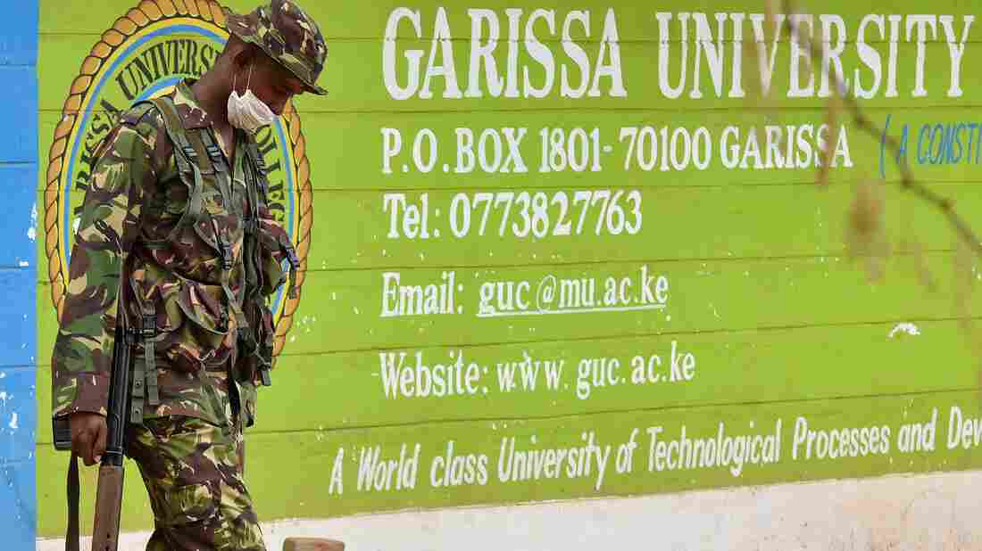 A Kenyan soldier walks past the front entrance of Garissa University College on Friday. Kenya's interior minister vowed that the country would not bow to terrorist threats, a day after the massacre of 147 students.