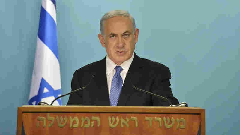 """A photo released by Government Press Office shows Israeli Prime Minister Benjamin Netanyahu as he delivers a statement on April 3 """"strongly opposing"""" the framework deal."""