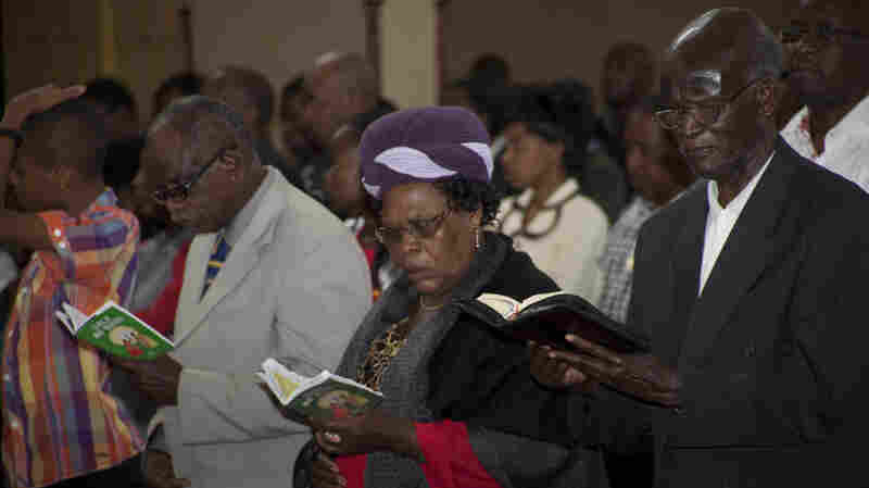 Kenyan Christians pray as they join a morning service at Holy Family Basilica in Nairobi, Kenya, on Sunday.