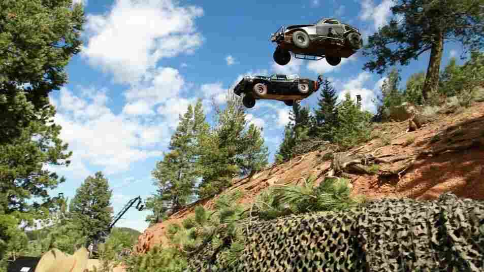 The beloved Dodge Charger of Dom Toretto (Vin Diesel) launches off Pikes Peak, Colo., followed by a member of the security force of Deckard Shaw (Jason Statham). Stunt coordinator Jack Gill planned and coordinated these stunts for Furious 7.