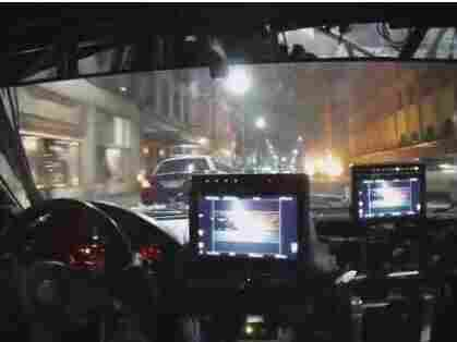 A camera car follows one of Furious 7's police chases through downtown Atlanta. The picture was snapped moments before the police car ahead on the left hits a parked car (which, of course, flips up in the air and explodes).