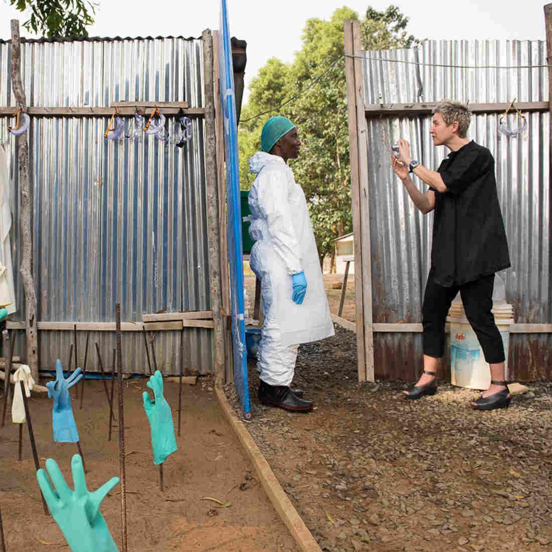 An Artist's Brainstorm: Put Photos On Those Faceless Ebola Suits