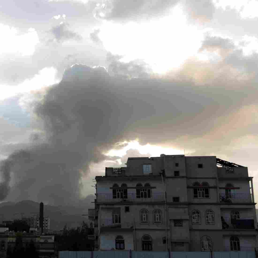 Smoke and flames reportedly from Shiite Houthi rebels' camps rise over part of the Yemeni capital, Sanaa, on Monday. Fierce fighting has left people trapped, including U.S. citizens.