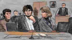 Dzhokhar Tsarnaev (center) is depicted in this courtroom sketch between defense attorneys Miriam Conrad (left) and Judy Clarke during his federal death penalty trial in Boston.