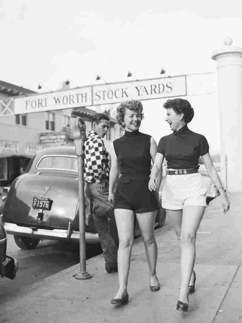 Two women in shorts — and a whistling bystander --amid a propriety debate in Fort Worth, Texas, 1952.