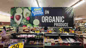 """Produce is often accompanied by signs like this one at a King Soopers grocery store in Fort Collins, Colo. But customers are often confused by their meaning, which is one reason the Organic Trade Association is trying to raise money for a """"checkoff"""" to pay for consumer advertising and research."""