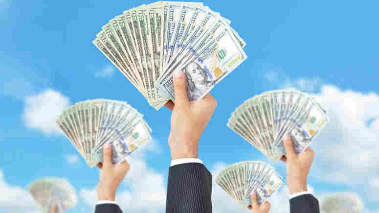 Hands holding money - United States dollar (USD) banknotes - money raising, funding & consumerism concept