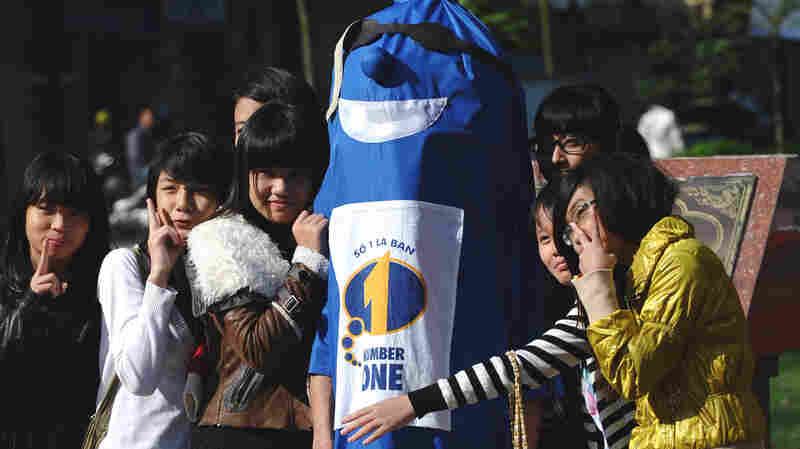 How do you get people to talk about condoms? A man in a condom costume is one tactic used in Vietnam.