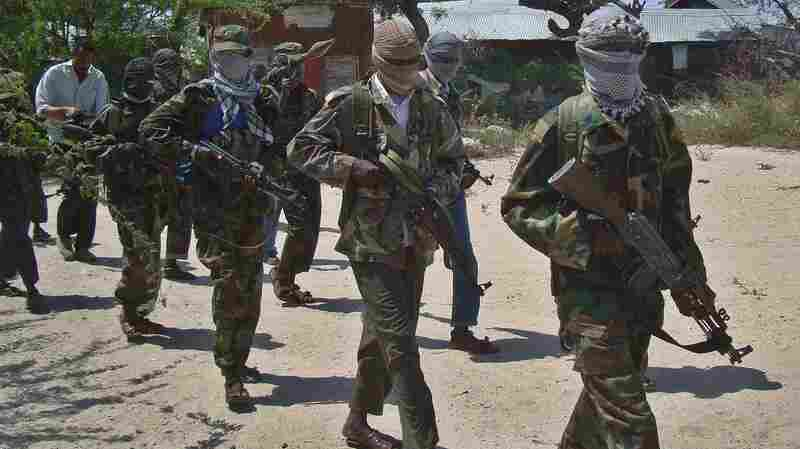 Al-Shabab recruits walk down a street on March 5, 2012, in the Somalian capital, Mogadishu, following their graduation. The militant group has transformed from being just a Somali group to a regional network in East Africa.