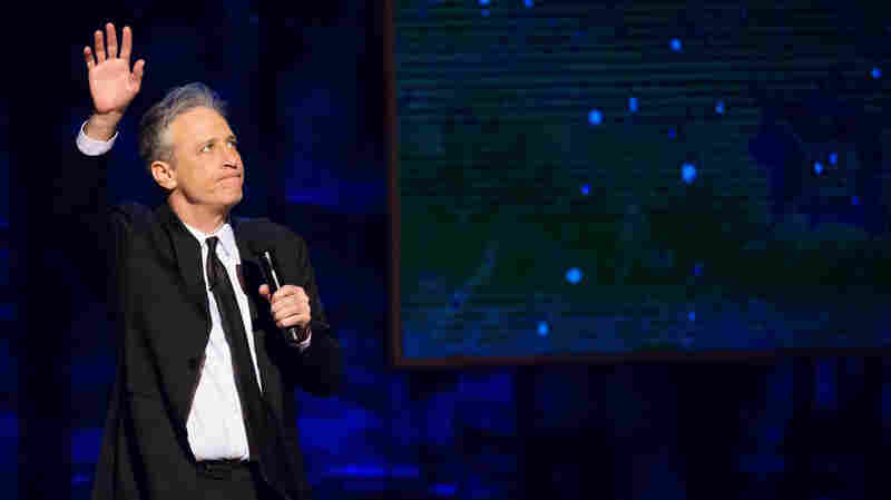 Jon Stewart appears onstage at Comedy Central's Night of Too Many Stars: America Comes Together for Autism Programs at the Beacon Theatre on Feb. 28 in New York. Stewart, host of The Daily Show, defended Trevor Noah, the man named to replace him, on the show Monday night.