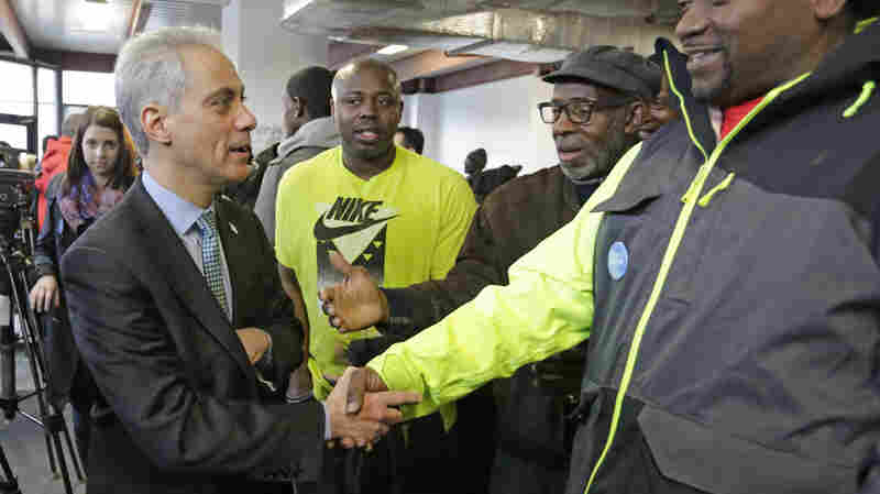 "Chicago Mayor Rahm Emanuel shakes hands at a campaign office Tuesday, as voters gave him a second term. He won a runoff election against Cook County Commissioner Jesus ""Chuy"" Garcia."