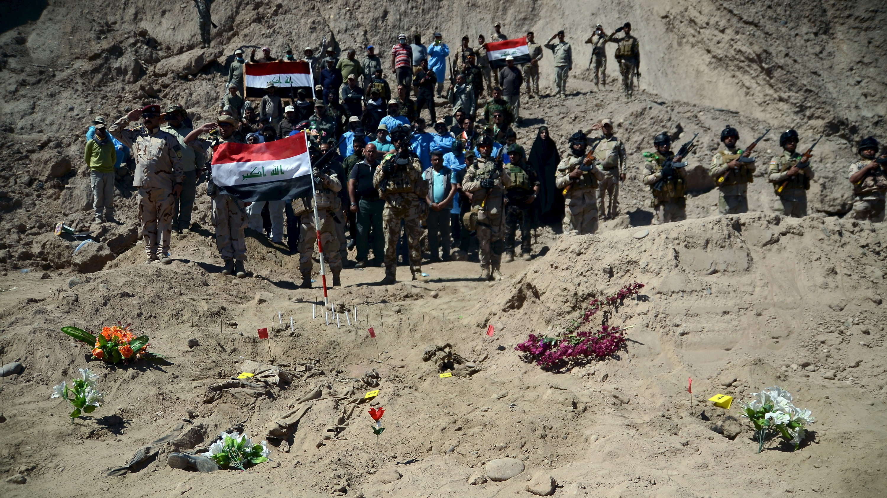 In Reclaimed Tikrit, Mass Graves From Brutal ISIS Occupation