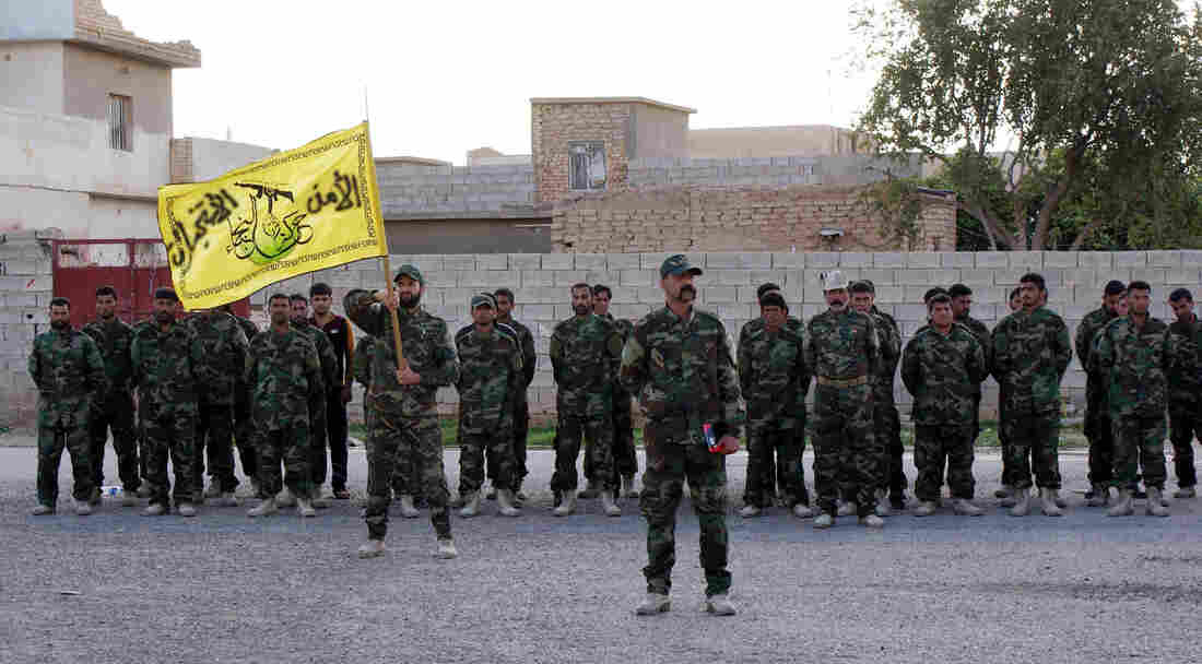 Members of the Shiite militia group Kataib Hezbollah train at a military base near Samarra, in northern Iraq, on March 5. The Shiite militia stands accused of retaliatory violence against Sunnis in an area it helped retake from ISIS.