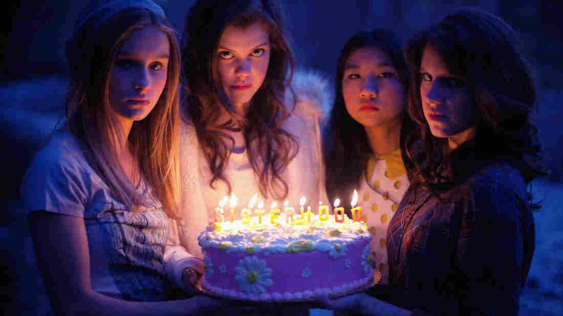 Olivia DeJonge, Georgie Henley, Willa Cuthrell, and Kara Hayward in The Sisterhood Of Night.