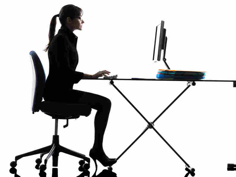Woman sitting at her computer.