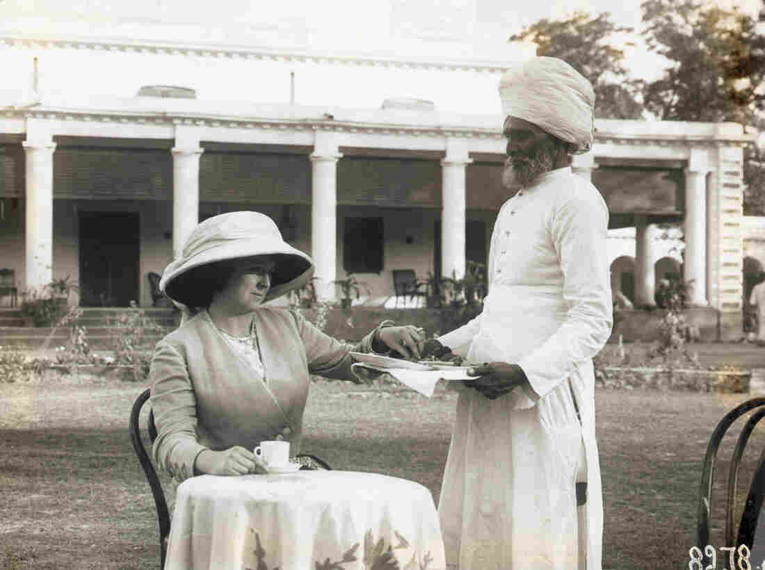 A Hindu servant serves tea to a European colonial woman in the early 20th century. The British habit of adding tea to sugar wasn't merely a matter of taste: It also helped steer the course of history.