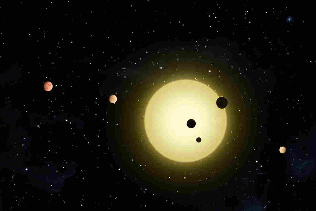 """This artist rendering shows Kepler-11, a sun-like star around which six planets orbit. A planet-hunting telescope is finding whole new worlds of possibilities in the search for alien life, including more than 50 potential planets that initially appear to be in habitable zones. The agency's chief scientist said Tuesday there will be """"strong indications"""" of alien life within a decade."""
