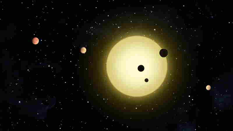 "This artist rendering shows Kepler-11, a sun-like star around which six planets orbit. A planet-hunting telescope is finding whole new worlds of possibilities in the search for alien life, including more than 50 potential planets that initially appear to be in habitable zones. The agency's chief scientist said Tuesday there will be ""strong indications"" of alien life within a decade."