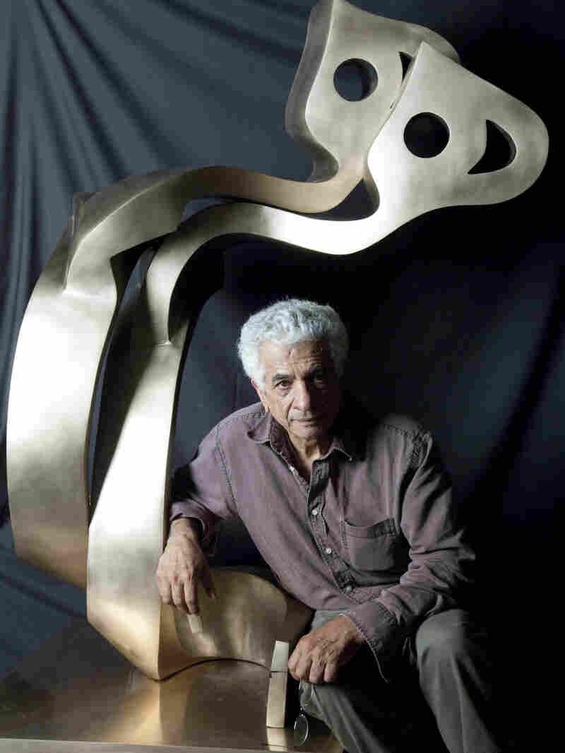 Artist Parviz Tanavoli with his sculpture Big Heech Lovers.
