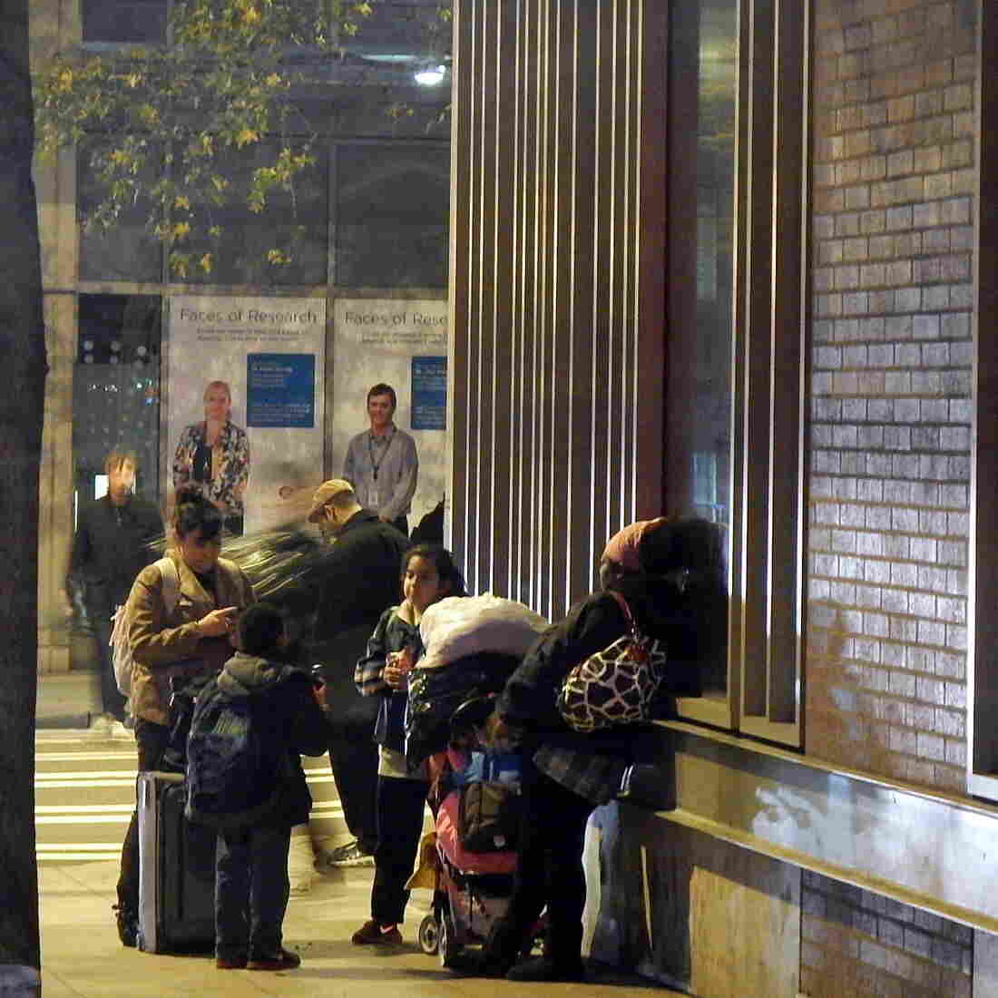 Homeless families outside a downtown Seattle shelter.