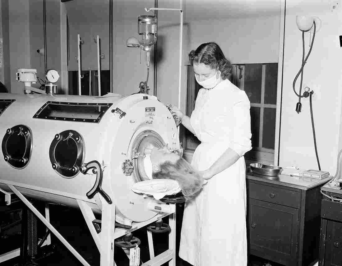A nurse assists a 27 year old patient in an iron lung in syracuse n y in 1954 for Polio transmission swimming pools