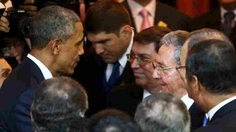 President Obama talks with Cuban counterpart Raul Castro before Friday's inauguration of the VII Summit of the Americas in Panama City.