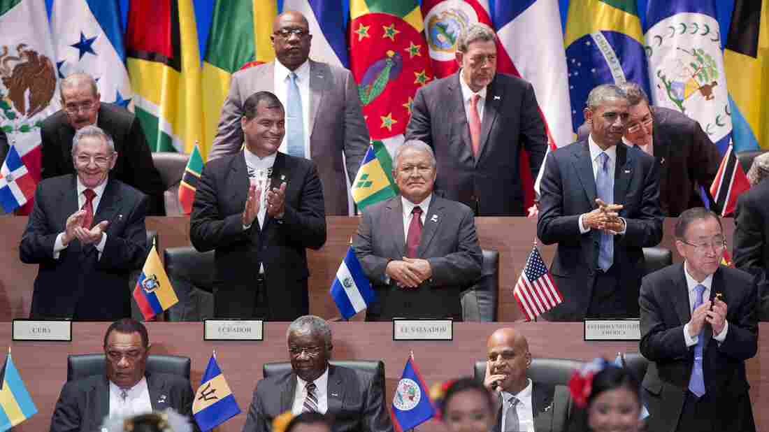 President Obama (right, middle row) and Cuba's President Raul Castro (left) applaud with other leaders during the the Summit of the Americas in Panama City on Friday.
