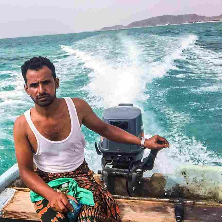 "A ""getaway selfie,"" as Mokhtar Alkhanshali calls it: Alkhanshali (left) makes his way across the Red Sea with this boat driver — and without navigation equipment."