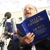 """Poet Allen Ginsberg reads his poem """"Howl"""" outside the U.S. Court of Appeals in Washington, D.C., Oct. 19, 1994, before a hearing on the constitutionality of a FCC policy restricting indecent material."""