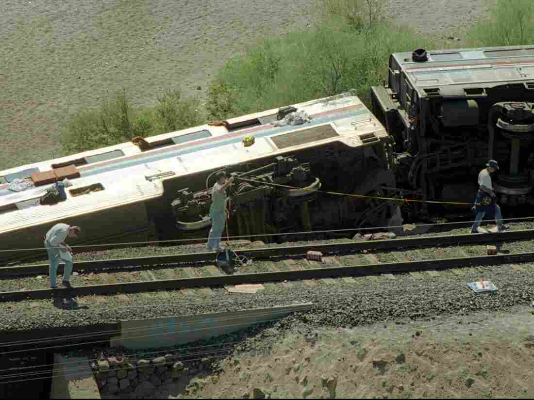 Federal investigators search for evidence at the scene of the Amtrak Sunset Limited wreckage near Hyder, Ariz., the day after the derailment.