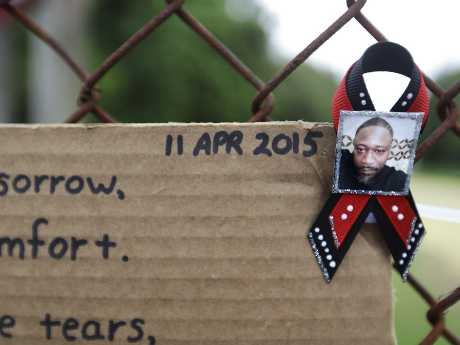 Makeshift memorials to Walter Scott sprouted up at the scene of his fatal encounter with Michael Slager, the police officer who shot him in the back as he ran away following a routine traffic stop. (David Goldman/AP)