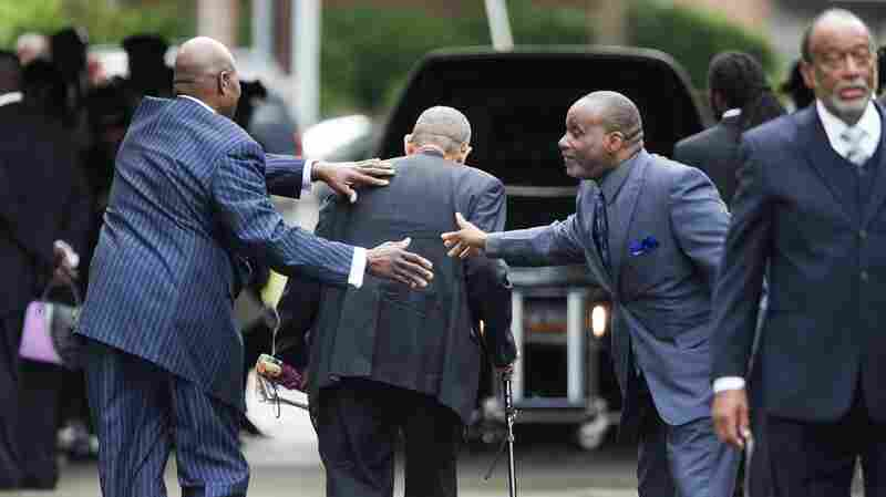 Mourners arrive for the funeral of Walter Scott at W.O.R.D. Ministries Christian Center in Summerville, S.C., on April 11, 2015.