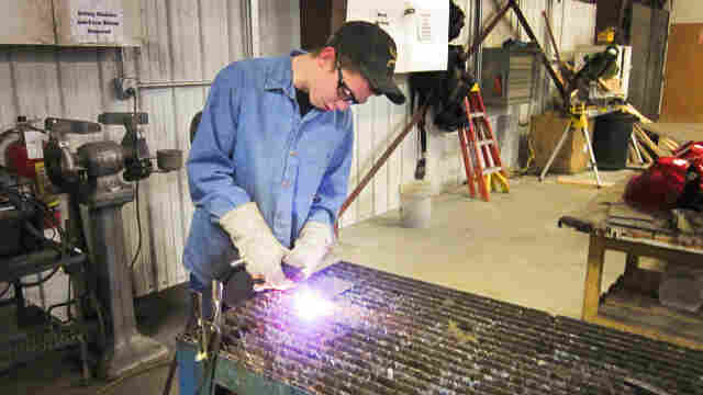 With the math done, student Kendall Hood works the plasma cutter.
