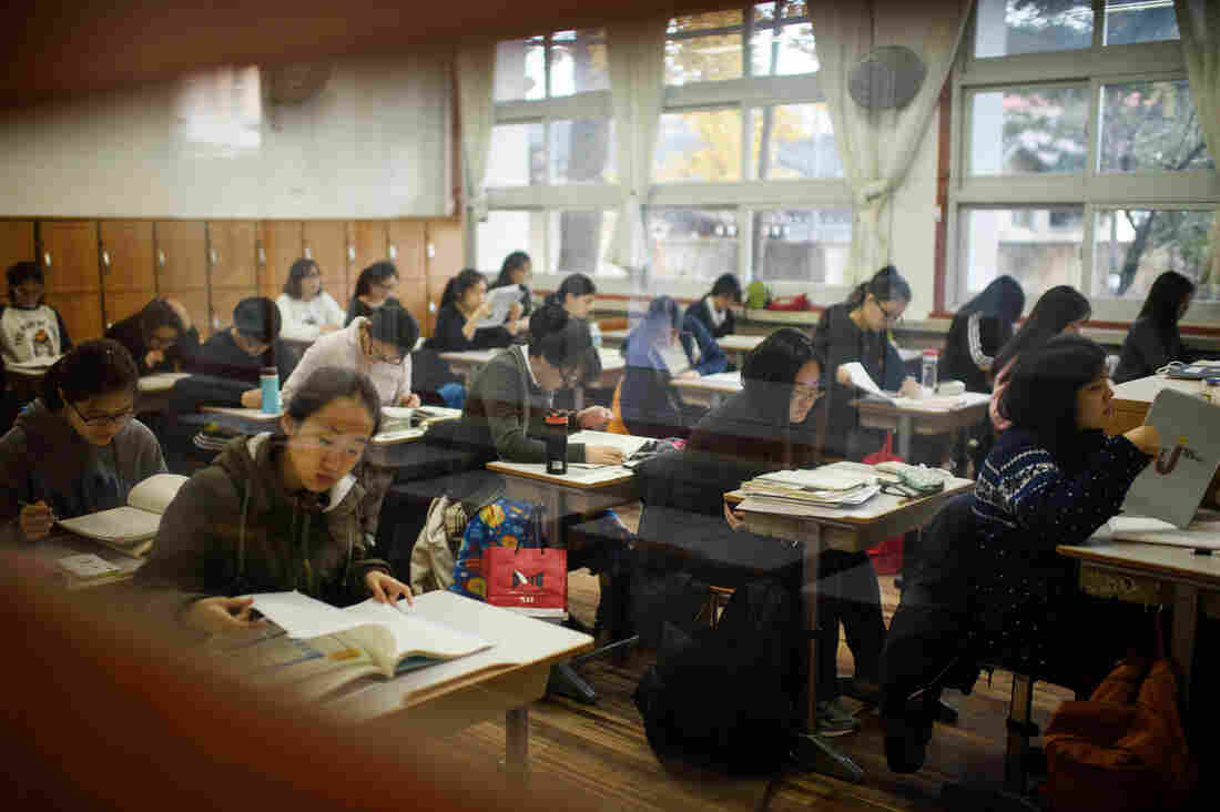 Students take the annual College Scholastic Ability Test, or college entrance exam, at a high school in Seoul last November. Students face enormous pressure to do well on the test and get into a top university. Airplanes are grounded on the day of the test so they won't disturb the students.