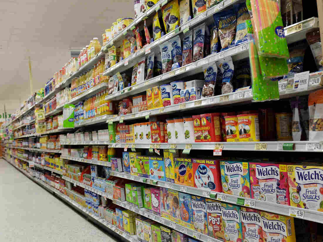 Food on display at a Miami supermarket. Advocacy groups say they're concerned that Americans are consuming foods with added flavors, preservatives and other ingredients that have never been reviewed by regulators for immediate dangers or long-term health effects.