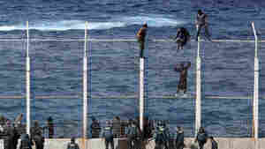 African migrants climb the fence that separates Morocco from the Spanish enclave of Ceuta in North Africa in February. Those who make it into Ceuta have reached Spanish — and European Union — soil. Their fate often depends on the country they came from. Some are deported, while others can apply for political asylum or for the status of economic migrant.