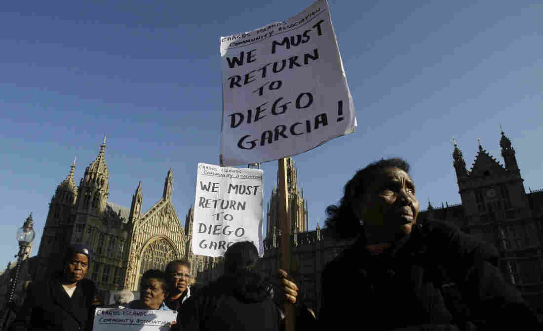 Women take part in a protest outside the Houses of Parliament in London in October 2008.