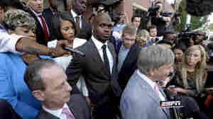 Minnesota Vikings running back Adrian Peterson (center) is seen following a court appearance last year in Conroe, Texas.