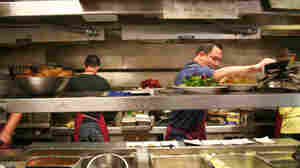 In the Fortune Garden kitchen in El Centro, Calif., near the Mexican border, cooks speak to each other in