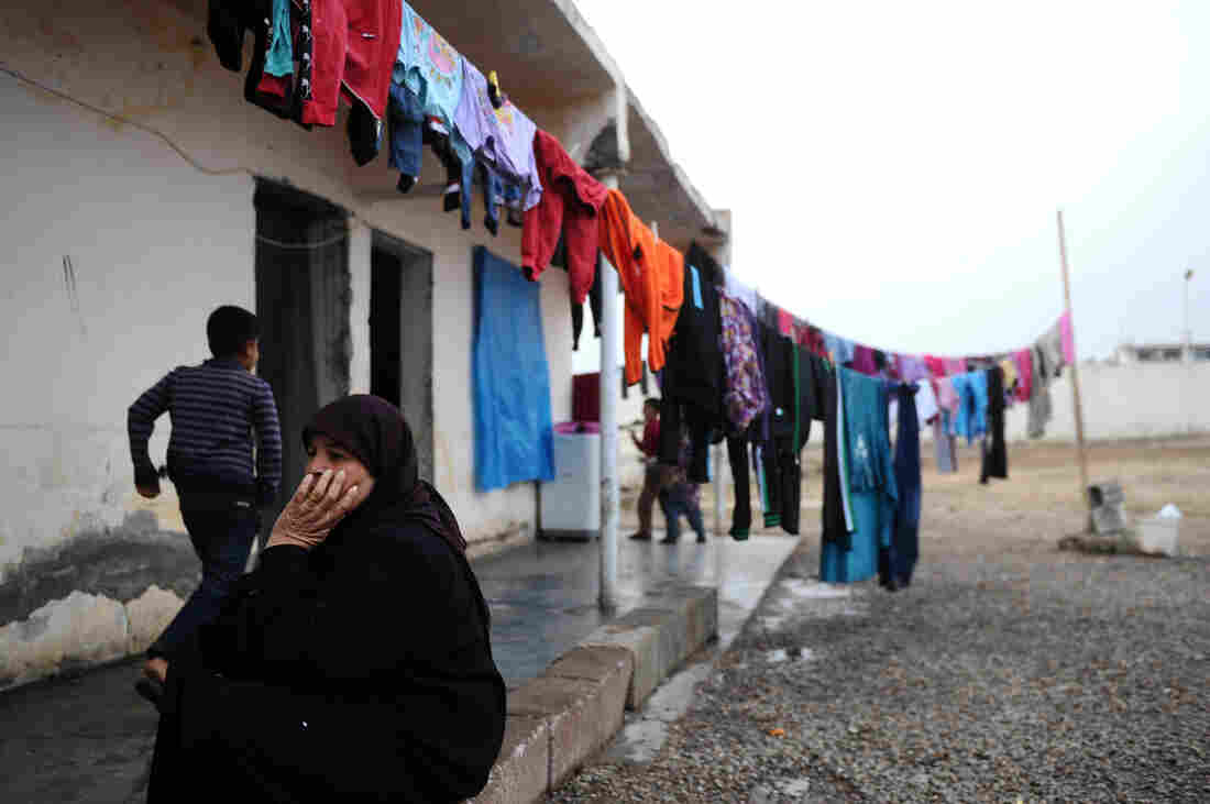 A Syrian woman sits in front of her house in a refugee camp in Reyhanli, Turkey, near the border crossing with Syria, on Jan. 15.