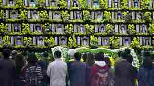 People pay tribute at a group memorial altar for victims of the sunken South Korean ferry Sewol at a remembrance hall in Ansan on Thursday.