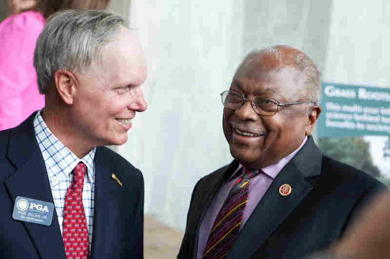 South Carolina Rep. James Clyburn talks with PGA professional Bob Dolan Jr. at the National Golf Day event on Capitol Hill. Clyburn is an avid golfer, and the Democrat says that earlier on in his career, he learned a lot about bipartisanship on the golf course.