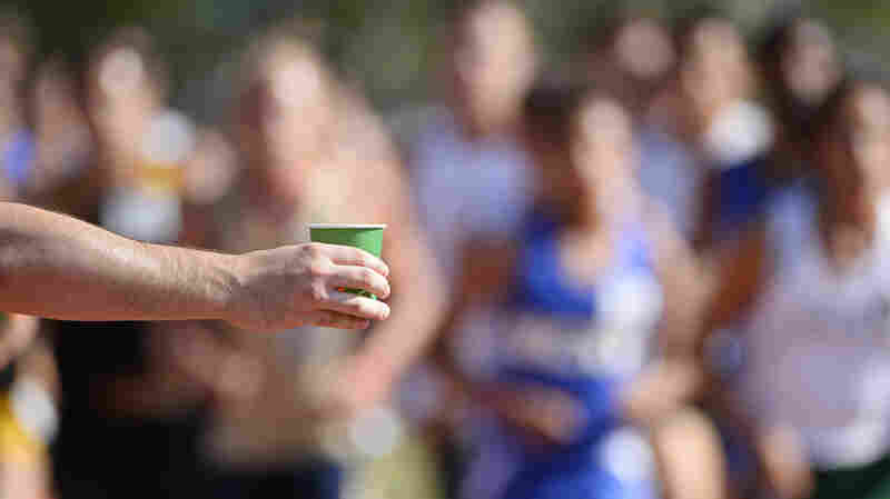 Performance nutrition experts recommend stopping at all the hydration stations for a quick fill-up of a sports drink to replenish the glycogen that's