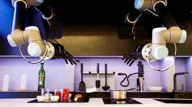 These robotic arms are part of a modular kitchen that's been set up so that the robot chef can find exactly what it needs.