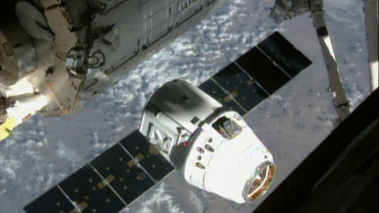The SpaceX Dragon cargo capsule nears the International Space Station on Friday, as astronauts prepare to snag it with a robotic arm.