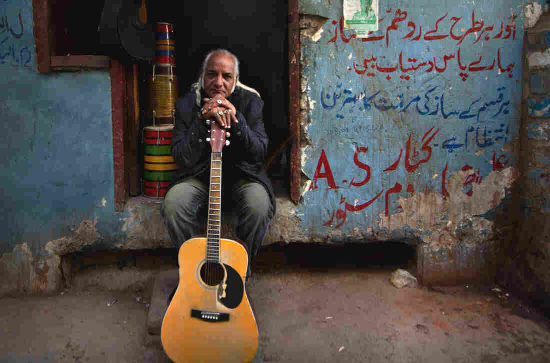 Asad Ali, 63, was unemployed for four years when Pakistan clamped down on live music in 1977. He now plays the guitar for Sachal Studios Orchestra around the globe and in his hometown, Lahore.