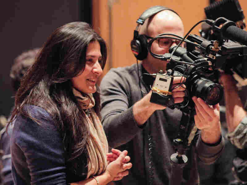 Oscar-winning filmmaker Sharmeen Obaid-Chinoy, left, co-directed Song of Lahore with producer Andy Schocken, right.
