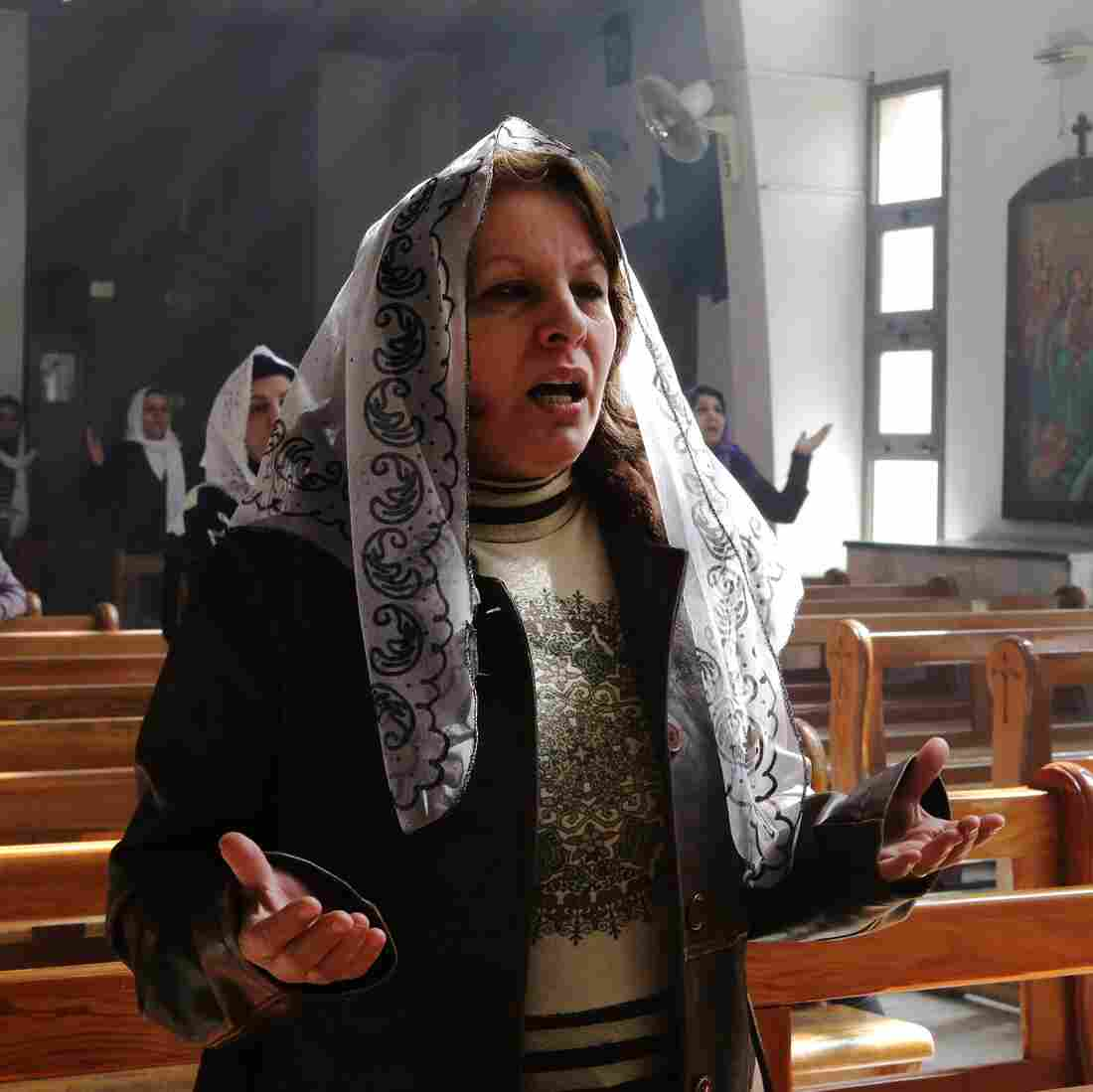 Assyrian Christians, who fled their homes because of attacks by the Islamic State, pray at a church on the outskirts of Damascus on March 1. Many minorities in Syria have tried to remain neutral in the conflict, but they often get caught up in the crossfire or are targeted by extremists.