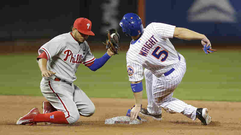 Philadelphia Phillies shortstop Freddy Galvis has the ball but the New York Mets' David Wright is safe on an eighth-inning stolen base in New York on Tuesday.